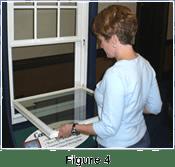 woman repairing dropping window